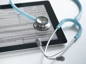 Studio shot of stethoscope and digital tablet with medical form
